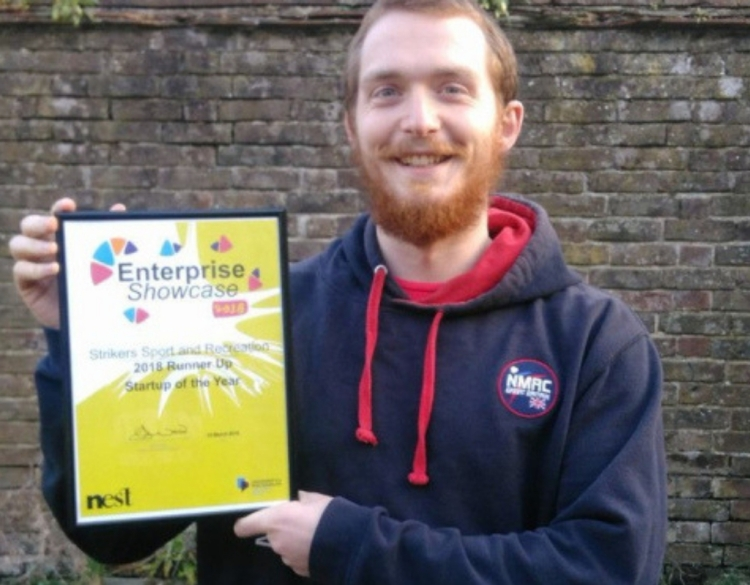 Strikers Director Jack Latoy holding Enterprise Showcase Startup of the Year Runner up certificate