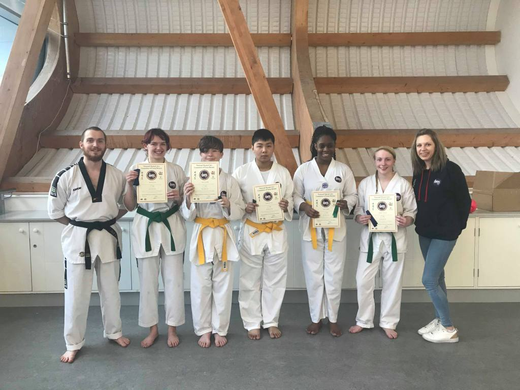 Strikers Taekwondo students holding certificates after grading