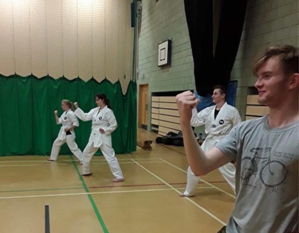Strikers TKD beginner class practising chest block
