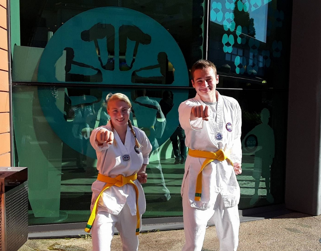 Strikers Taekwondo yellow belts demonstrating front punch